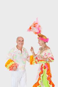 Happy senior dancing couple in Brazilian outfits dancing oveの写真素材 [FYI03646301]