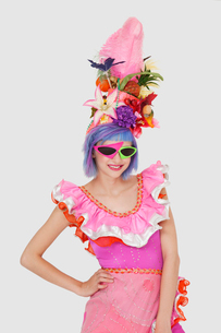 Portrait of beautiful young woman in Brazilian outfit and fuの写真素材 [FYI03646302]