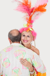 Portrait of senior couple in Brazilian outfits dancing overの写真素材 [FYI03646305]
