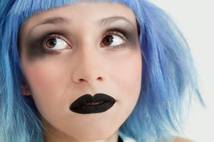 Close-up of young female punk with black lipstick, eye make-の写真素材 [FYI03646331]