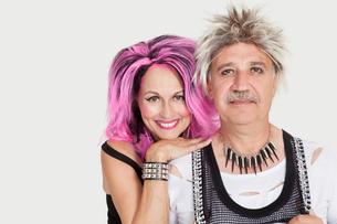 Portrait of senior punk couple over gray backgroundの写真素材 [FYI03646332]