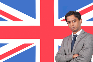 Portrait of young businessman with arms crossed over Britishの写真素材 [FYI03646468]