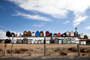 Front view of rows of mailboxes in desertの写真素材 [FYI03646479]