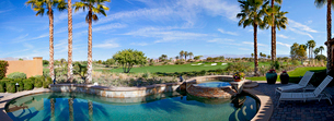 Panoramic view of swimming pool, hot tub and golf courseの写真素材 [FYI03646632]