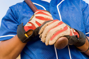 Baseball player holding batter (close-up) (mid section)の写真素材 [FYI03647356]