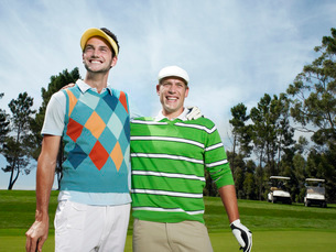 Two young male golfers on greenの写真素材 [FYI03647841]