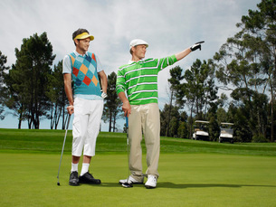 Two male golfers on greenの写真素材 [FYI03647842]