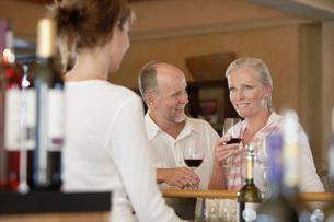 Man and woman wine-tasting selective focusの写真素材 [FYI03647921]