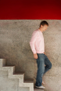Man running down stairs blurred motion full lengthの写真素材 [FYI03647938]