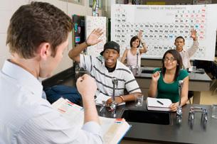Teacher Calling on Student in Science Classの写真素材 [FYI03648579]