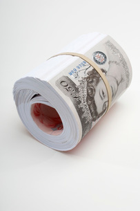 Roll of British paper currencyの写真素材 [FYI03648779]