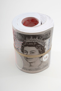 Roll of British paper currencyの写真素材 [FYI03648780]