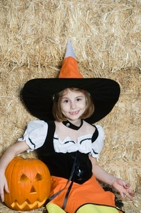 Portrait of girl (7-9) wearing witch costume by hayの写真素材 [FYI03648840]