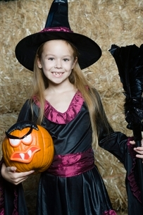 Portrait of girl (7-9) wearing witch costume by hayの写真素材 [FYI03648843]