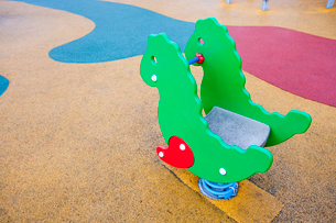 Playground horse with colored rubber flooringの写真素材 [FYI03648975]