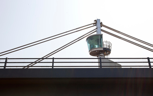 Close-up view of a control tower on top of a bridgeの写真素材 [FYI03649137]