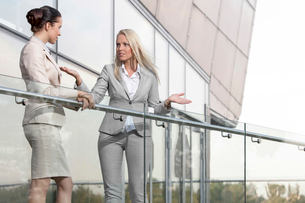 Young businesswoman arguing with female colleague at office balconyの写真素材 [FYI03649288]