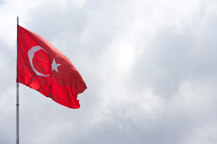 Turkish flag flying in the airの写真素材 [FYI03649320]