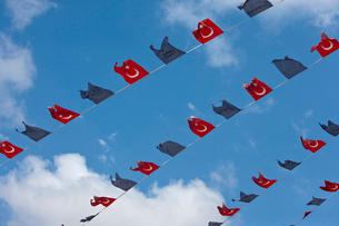 Close-up view of Turkish and EU bunting against clear skyの写真素材 [FYI03649325]