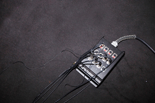 Wires attached to electric box in television studioの写真素材 [FYI03649371]