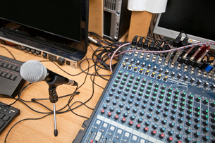 Microphone and sound mixing equipment at television studioの写真素材 [FYI03649378]