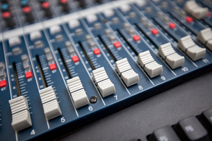 Close-up of sound mixing equipment in television studioの写真素材 [FYI03649380]