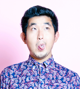 Young Geeky Asian Man in colorful shirt pulling funny faceの写真素材 [FYI03649454]