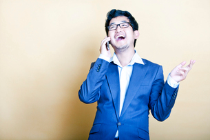 Stylish Asian man on the telephoneの写真素材 [FYI03649472]