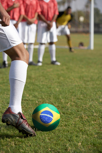 Soccer players preparing for a free kick in front of Brazilian flagの写真素材 [FYI03649795]