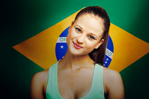 Beautiful Young woman smiling standing in front of Brazilian flagの写真素材 [FYI03649870]