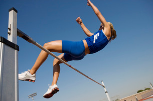 Female athlete high-jumping low angle viewの写真素材 [FYI03650087]