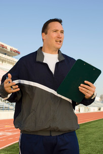 Sports coach giving instructionsの写真素材 [FYI03650137]