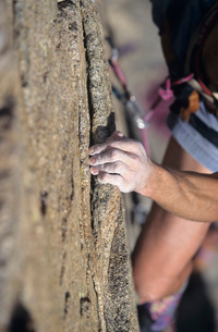 Rock Climber holding on to cliff close-upの写真素材 [FYI03650183]