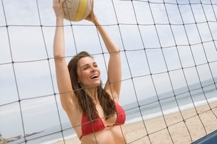 Woman in red bikini at volleyball netの写真素材 [FYI03650587]