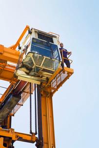 Limassol Cyprus Operator having a break on gantry of mobile craneの写真素材 [FYI03650688]