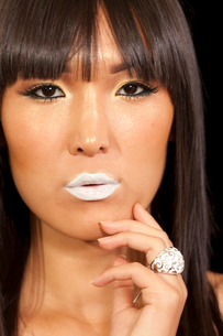 Portrait of young woman wearing beautiful ring with white lipstickの写真素材 [FYI03650821]
