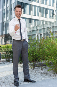 Full length portrait of successful businessman outside office buildingの写真素材 [FYI03651201]