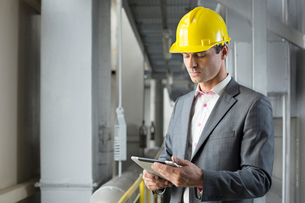 Young male architect using tablet computer in industryの写真素材 [FYI03651237]