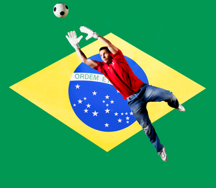Football Goalkeeper saving shot in front of Brazil National Flagの写真素材 [FYI03652585]