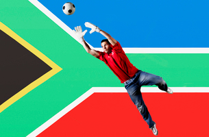 Football Goalkeeper saving shot in front of South Africa National Flagの写真素材 [FYI03652586]