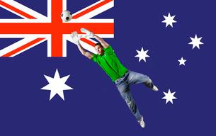 Football Goalkeeper saving shot in front of Australian National Flagの写真素材 [FYI03652588]