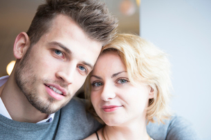 Close-up portrait of young couple in cafeの写真素材 [FYI03652775]