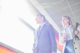 Low angle view of business people walking in railroad stationの写真素材 [FYI03652897]