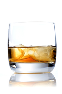 Glass of whisky on white backgroundの写真素材 [FYI03653964]