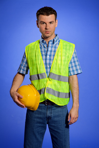 Portrait of architect in coveralls holding hardhatの写真素材 [FYI03654983]
