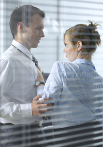 Businesswoman flirting with his colleague in officeの写真素材 [FYI03655448]