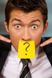 Portrait of businessman in office with question mark written onの写真素材 [FYI03655520]