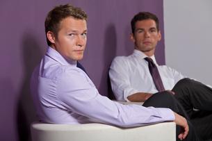 Portrait of businessmen sitting at officeの写真素材 [FYI03656057]