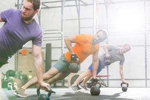 Men exercising with kettlebells in crossfit gymの写真素材 [FYI03656203]