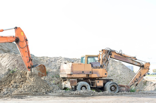 Bulldozers on construction site against clear skyの写真素材 [FYI03656929]